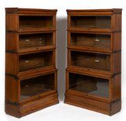 A pair of 19th century oak Globe Wernicke four tier bookcases each 87cm wide x 32cm deep x 153cm