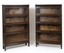 A pair of stained oak Globe Wernicke four tier bookcases, each 86.5cm wide x 27cm deep x 143cm