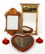 A Georgian style walnut fret framed wall mirror of 20th century construction, 30cm wide x 51cm high;