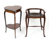 An Edwardian rosewood and bone inlaid heart shaped occasional table with cabriole legs united by