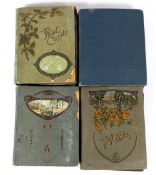 Four early 20th century postcard albums with humorous postcards, Christmas, children, horses,