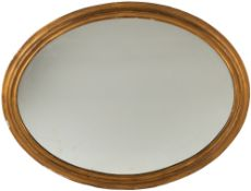 A gilded oval wall mirror, 86cm wide x 102cm highCondition report: Back board loose in areas, some