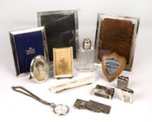 A group of four silver mounted photograph frames, together with a white metal pocket watch, two
