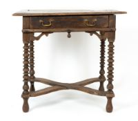 An antique and later elm topped side table with single drawer, brass swan neck handles, bobbin
