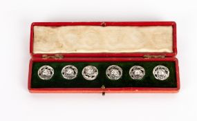 A set of six white metal art nouveau buttons with original box and numbered 352928, each 1.7cm