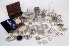 A collection of silver plated wares to include a teapot, hot water jug, serving dishes