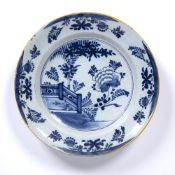 An antique Dutch Delft charger 35.5cm diameter Condition report: minor frits and losses to the glaze
