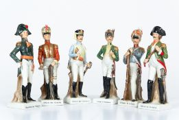 Seven 20th century porcelain figurines depicting soldiers, each 23cm highCondition report: