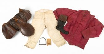 A 19th Century horse racing saddle, a boot racing silks, a stirrup and a photograph all reputedly