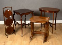 A small group of occasional furniture to include an Edwardian mahogany three tier cake stand; a