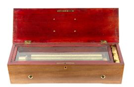 An early 20th century Swiss cylinder music box the mechanism numbered 35677, in a mahogany and