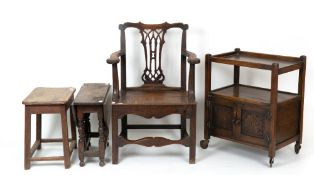 An 18th century oak armchair with a pierced splat, a panelled seat and square legs, 63cm wide x 47cm
