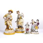 A Chelsea style porcelain figurine 'Couple Dancing', 13cm wide x 19cm high together with a pair of