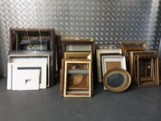 A collection of approximately sixty picture frames of varying sizes from 25 x34 cms to 50 x64cms;