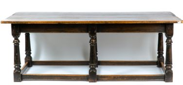 An early 20th century oak refectory table with turned supports united by stretcher, 213cm wide x