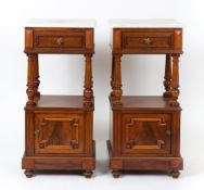 A pair of white marble topped walnut bedside cabinets each with single drawers above fluted turned