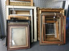 A collection of approximately 25 picture frames 19th and 20th century, sizes from 60 x52 cms to
