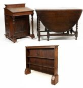 A late 19th century walnut Davenport, 53cm wide; an oak bookcase 114cm wide; a 1930's oak gateleg