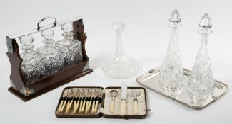 A modern silver plate mounted tantalus together with a pair of cut glass decanters, a silver