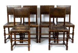 A set of six late 19th / early 20th century oak and leather upholstered chairs with turned supports,