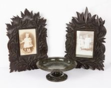 A pair of Eastern carved hardwood picture frames each 22cm wide x 34cm high together with a