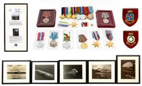 A collection of medals awarded to Veteran John Davis RN Service Number FX105490 who served on HMS