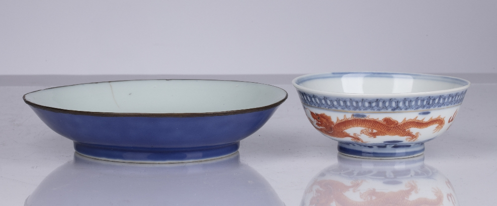 Two porcelain bowls Chinese, 18th Century and later comprising of a shallow blue glazed dish, - Image 3 of 5