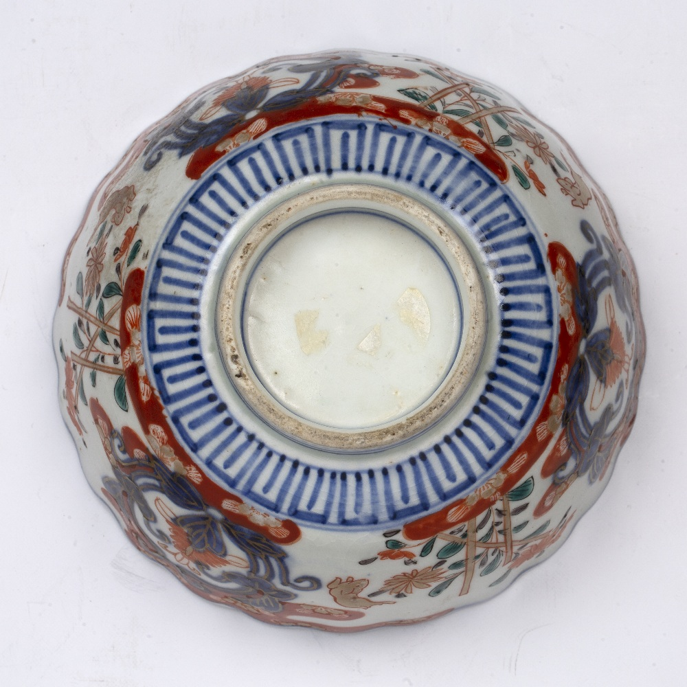 Imari bowl Japanese, 19th Century decorated with leaping rabbits beside stacked flowers divided by - Image 5 of 5