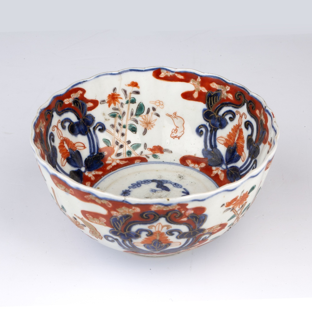Imari bowl Japanese, 19th Century decorated with leaping rabbits beside stacked flowers divided by