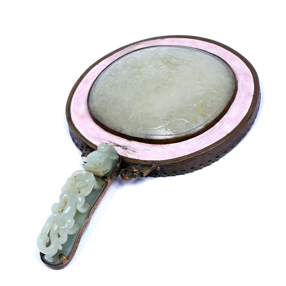 Jade and metal mounted hand mirror Chinese, 18th/19th Century the jade plaque on the top carved with