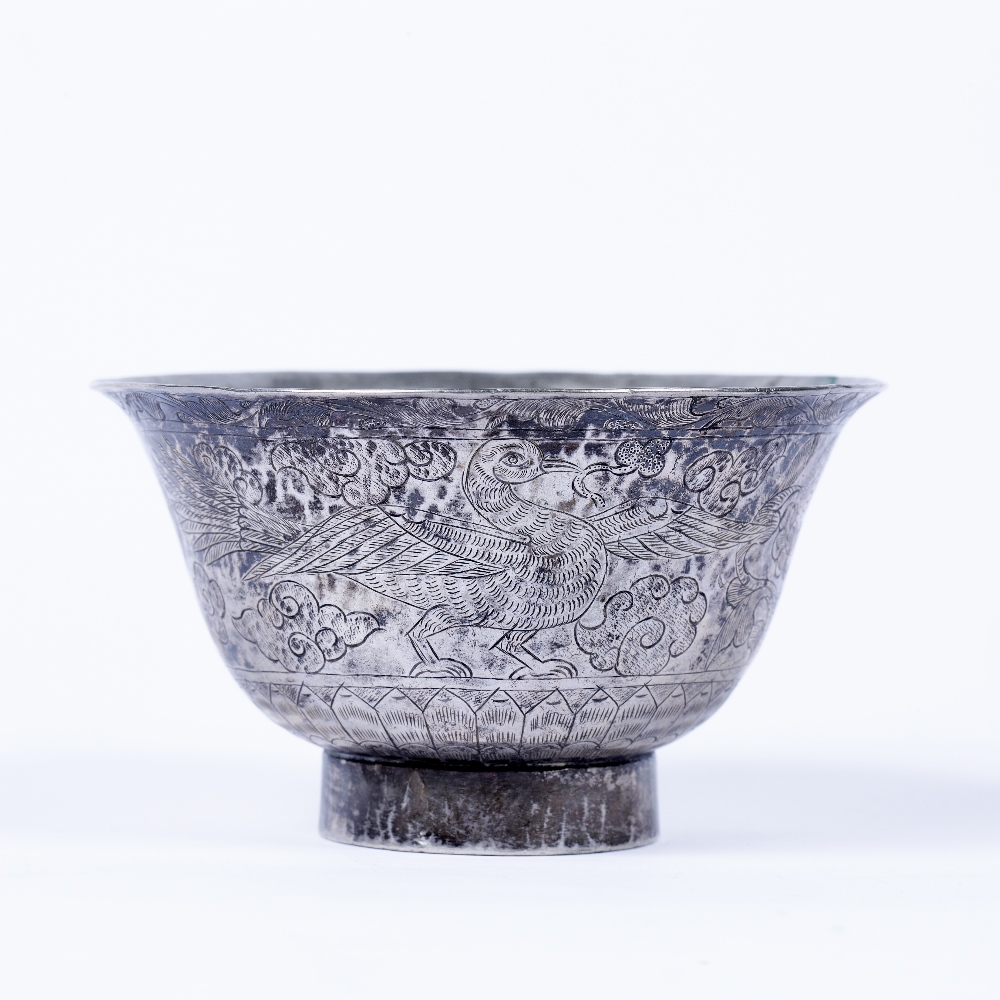 Silver bowl Chinese, 19th Century of flared form, engraved with dragons and phoenix in the sky,