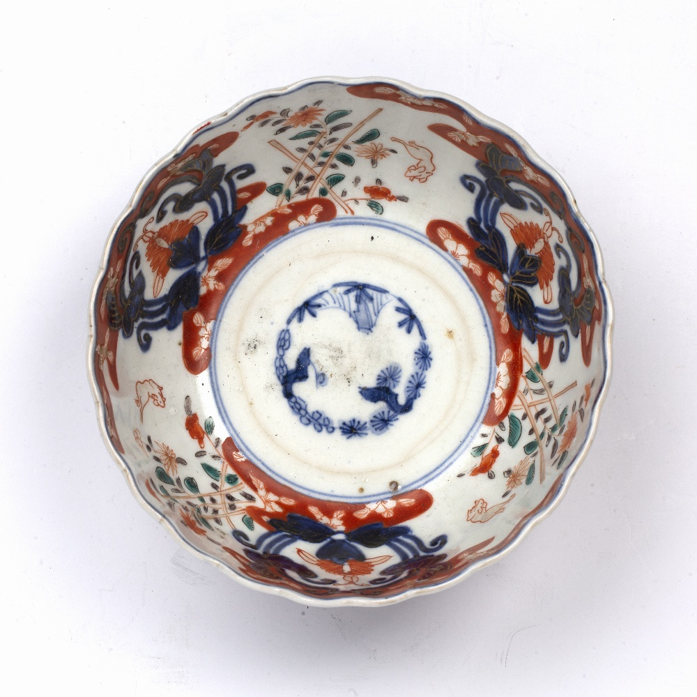 Imari bowl Japanese, 19th Century decorated with leaping rabbits beside stacked flowers divided by - Image 4 of 5