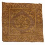 Gold ground rug Chinese with traditional motifs, 80cm x 76cm Condition: wear and losses to the