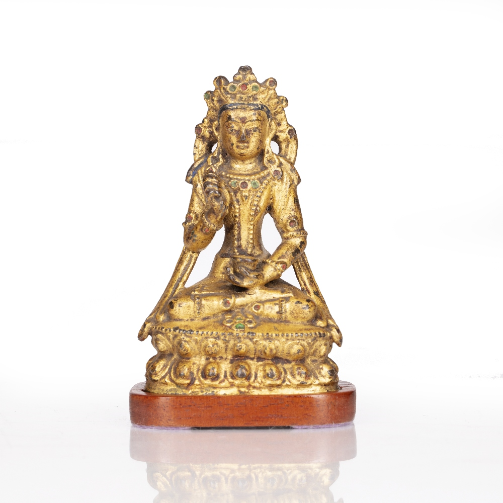 Miniature gilt bronze figure of Avalokiteshvara Chinese, late 18th Century on a double lotus base,
