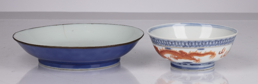 Two porcelain bowls Chinese, 18th Century and later comprising of a shallow blue glazed dish, - Image 2 of 5