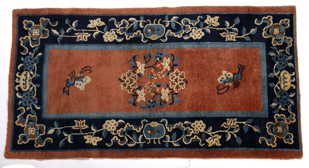 Peking runner Chinese decorated to the centre with butterflies and flowers in ground orange,