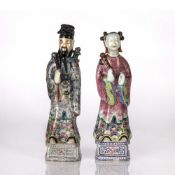 Pair of porcelain figures Chinese, 19th/20th Century depicting male and female officials, dressed in