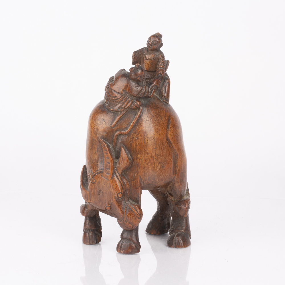 Root carving Chinese depicting two figures riding a water buffalo, 23cm high Condition: the two