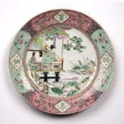 Famille rose charger Chinese, late 19th Century decorated in enamels with a girl holding a fan