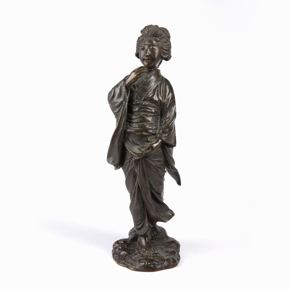 Bronze figure of a Geisha Japanese, Meiji period the figure depicted walking holding her kimono