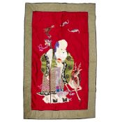 Large embroidered panel of Shulao Chinese the standing figure set on a silk red ground, overall size