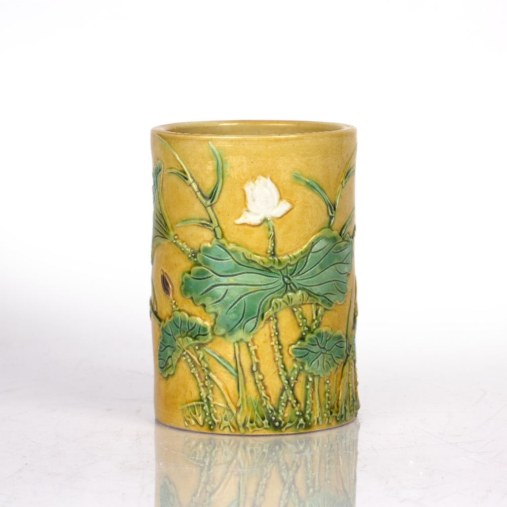 Yellow glazed brushpot Chinese, 19th Century the exterior with moulded decoration depicting