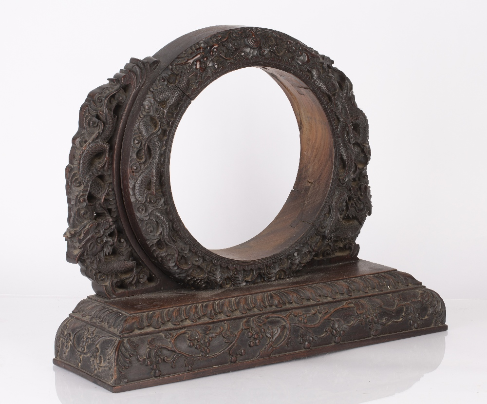 Hardwood stand Chinese, circa 1880 of circular form, the dragons carved to the border on a heavy - Image 2 of 2