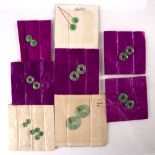 Collection of jade roundels Chinese to include twenty, sewn into their original cloth packets (20)