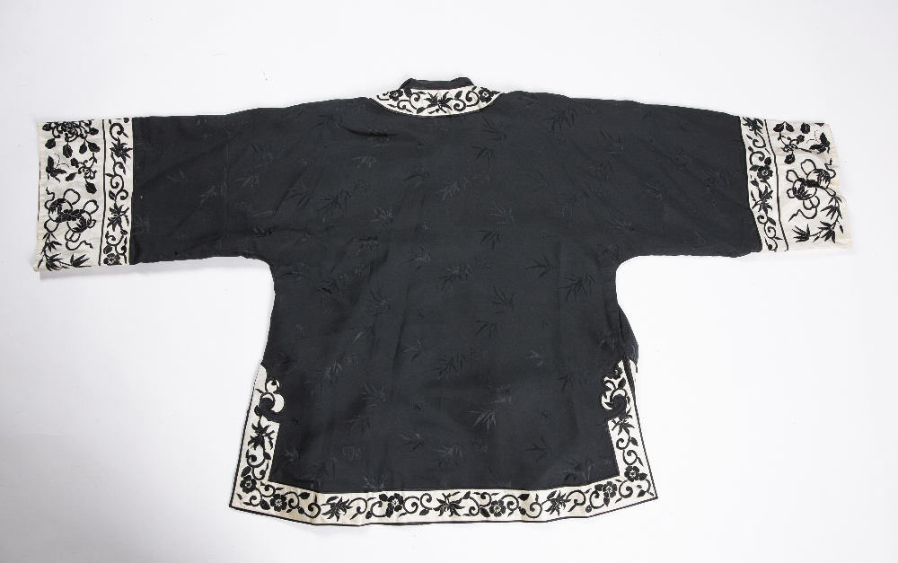 Two embroidered jackets Chinese, 20th Century decorated to the exterior with crashing waves near the - Image 2 of 2