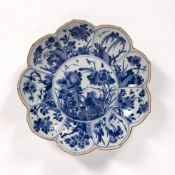 Blue and white lotus shaped dish Chinese, Kangxi (1662-1722) painted with flowers and insects within