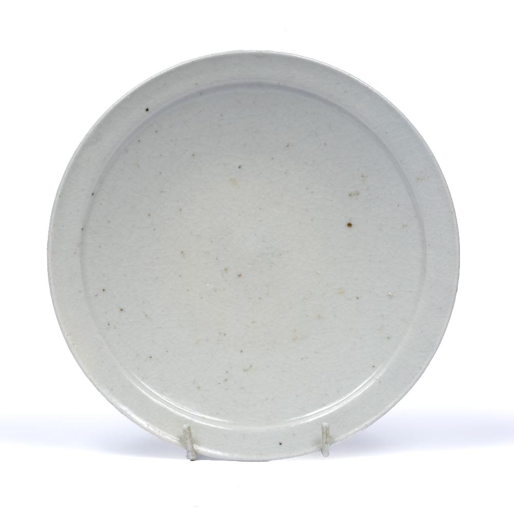 White glaze dish Korean, 16th Century finished with a raised rim, 19cm diameter Condition: Crazing