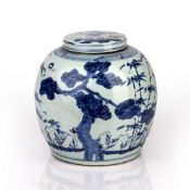 Blue and white lidded jar Chinese, 19th Century decorated to the body with bamboo and pine trees,