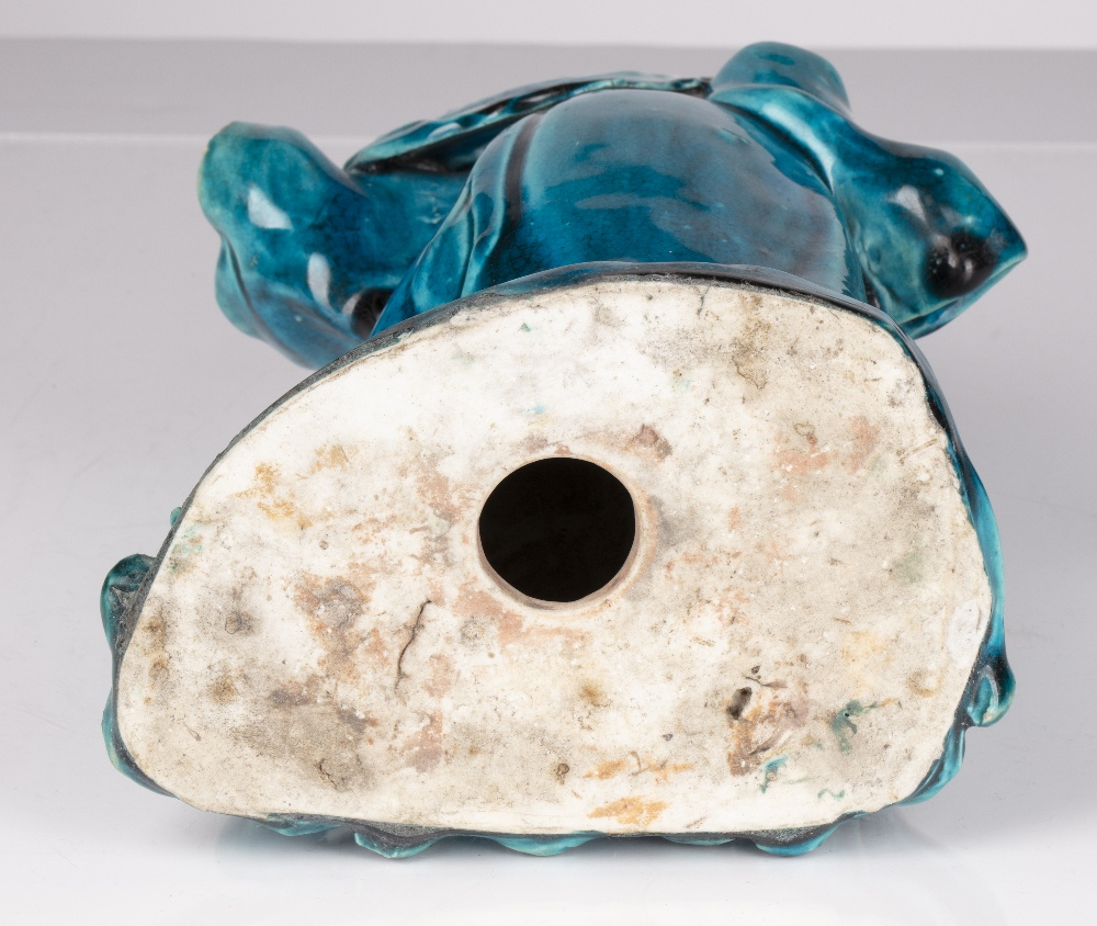 Turquoise glazed Lohan Chinese, 18th/19th Century the slightly stooped figure holding a peach in his - Image 3 of 3