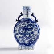 Blue and white moonflask Chinese, 19th century decorated to the centre with a four clawed dragon